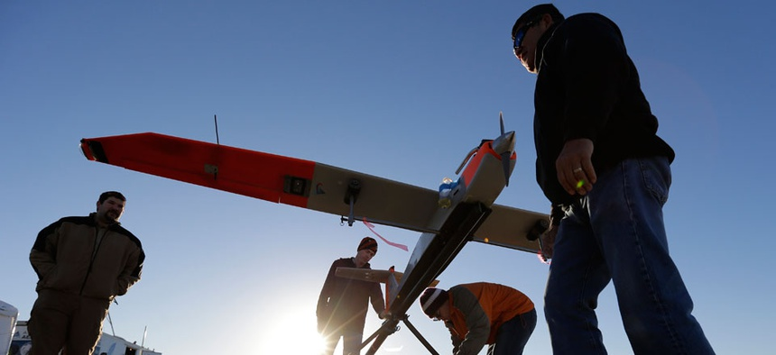 Texas A&M Corpus Christi researchers prepare a unmanned aircraft system for testing at a ranch near Sarita, Texas.