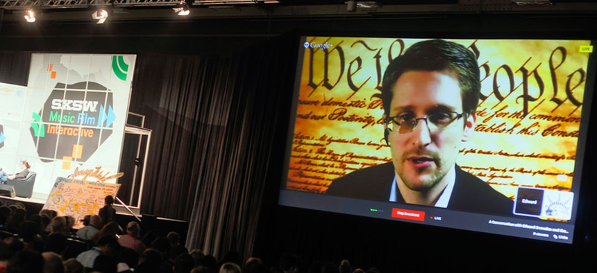 Edward Snowden talks during a simulcast conversation during the SXSW Interactive Festival on Monday, March 10, 2014.