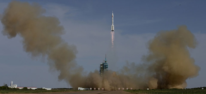 The Long March 2F rocket carrying the Shenzhou 10 capsule blasts off in China in 2013.