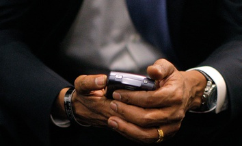 Then-Democratic presidential candidate, Sen. Barack Obama, D-Ill., checks his BlackBerry in 2008.