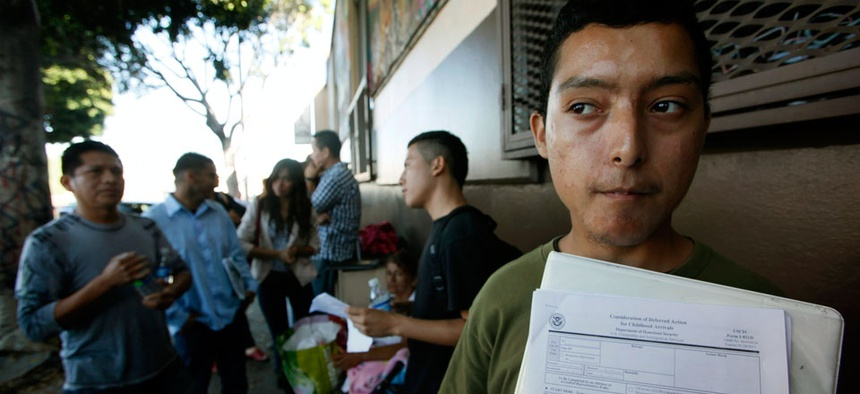 Illegal immigrant Layios Roberto waits outside the offices of Coalition for Humane Immigrant Rights with application papers in Los Angeles.