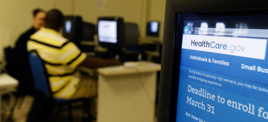 Two Atlanta residents fill out HealthCare.Gov applications at the Atlanta Medical Center South Campus Monday.