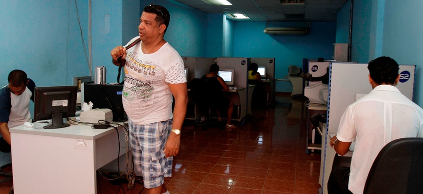 A man leaves a state-run computer center in Havana in 2012.