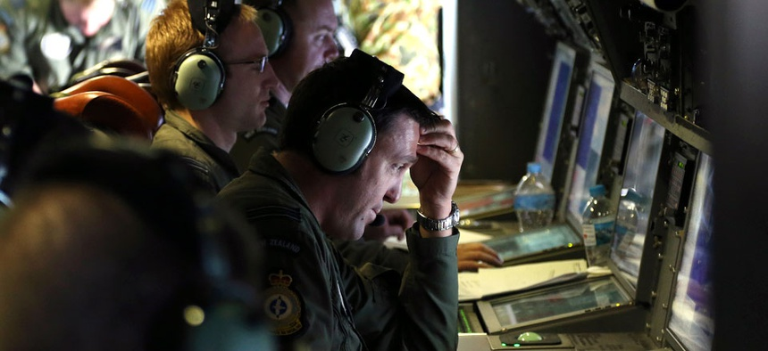 Operators monitors TAC stations onboard a Royal New Zealand Air Force P3 Orion during search operations for wreckage and debris of missing Malaysia Airlines Flight MH370 in the southern Indian Ocean.