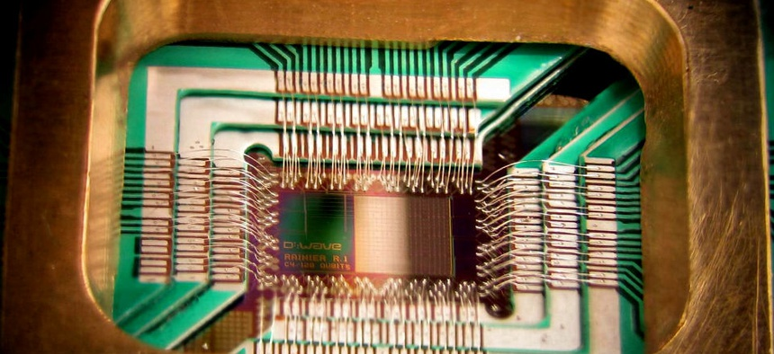 A chip constructed by D-Wave Systems Inc. designed to operate as a 128-qubit superconducting adiabatic quantum optimization processor, mounted in a sample holder.