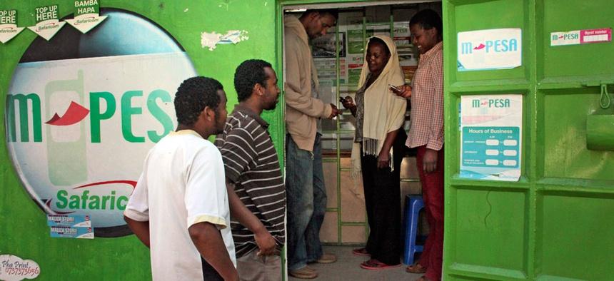 Customers make money transfers at an M-Pesa counter in Nairobi, Kenya.