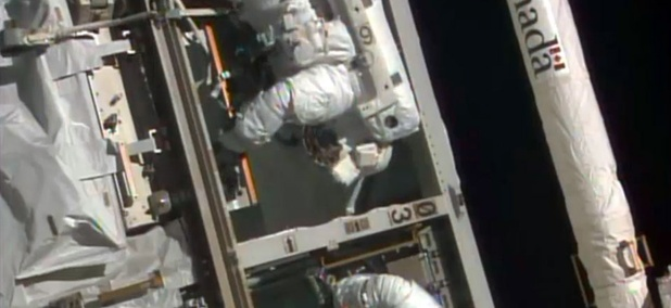 NASA astronauts Steven Swanson, left, and Rick Mastracchio perform a spacewalk outside the International Space Station.