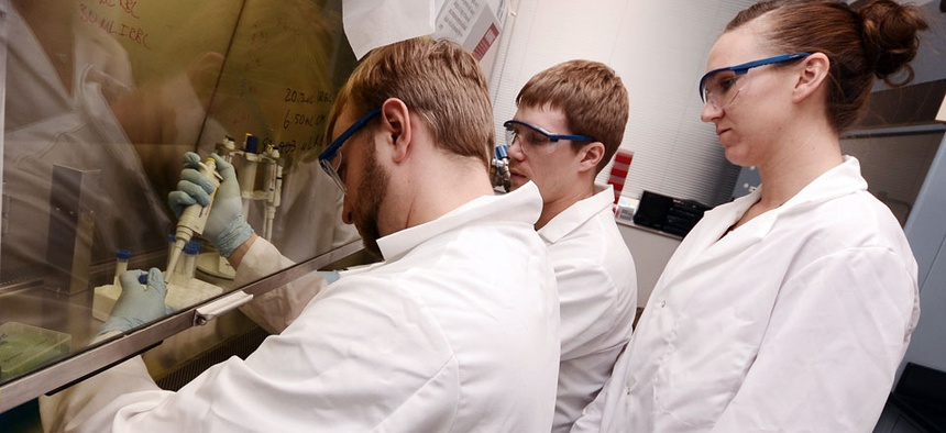 Biology and chemistry graduate students work in a lab at the university in Sioux Falls, SD.