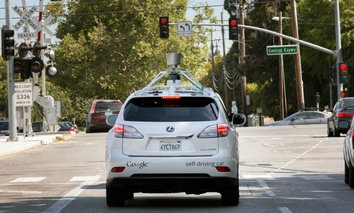 The Google driverless car navigating along a street in Mountain View, Calif.