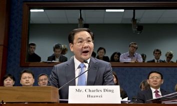 House Permanent Select Committee on Intelligence holds a hearing with Charles Ding, center, Huawei Technologies senior vice president for the U.S.
