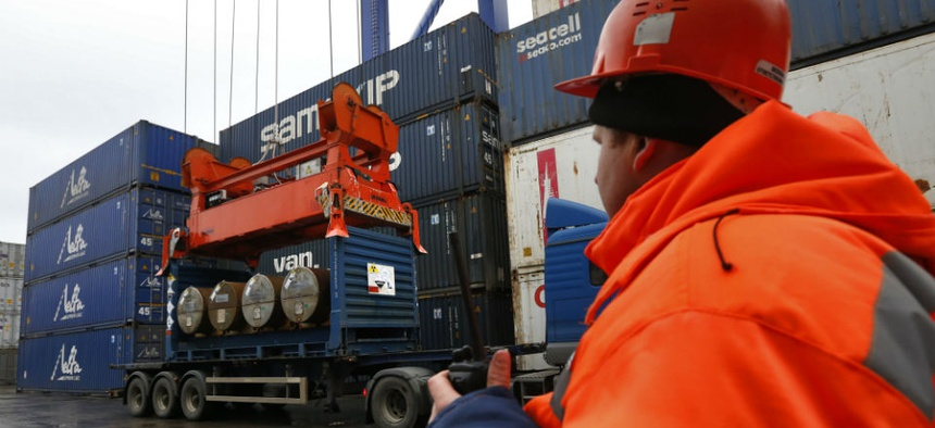 A crane picks up containers with uranium to be used as fuel for nuclear reactors to load them aboard the Atlantic Navigator ship, on a port in St. Petersburg, Russia.