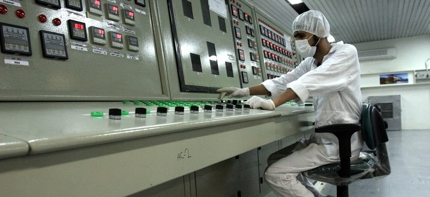 An Iranian technician works at the Uranium Conversion Facility just outside the city of Isfahan in 2007.