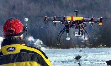 Steve Capachietti pilots his drone with video camera attached on the bottom while taking video.