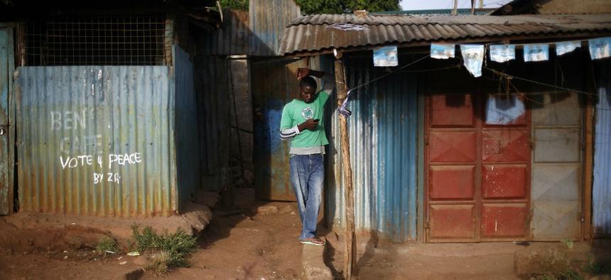 A man checks his phone in Nairobi, Kenya.