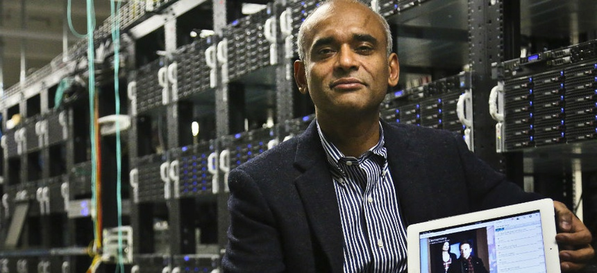Chet Kanojia, founder and CEO of Aereo, Inc., poses with a tablet displaying his company's technology.