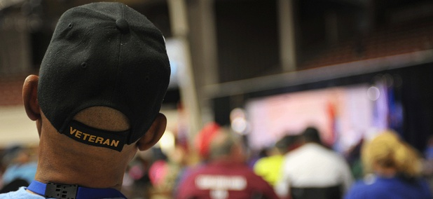 A man watches the Opening Ceremonies of the 28th National Veterans Golden Age Games.