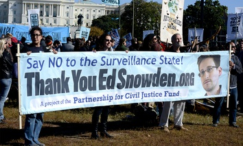 Protestors hold up a sign supporting Edward Snowden at an October rally in DC.
