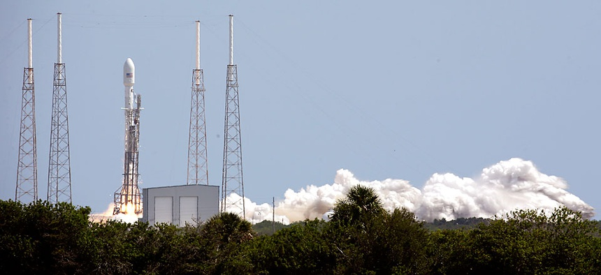 A SpaceX Falcon 9 rocket, carrying a payload of Orbcomm communications satellites, lifts off from launch complex 40 at the Cape Canaveral Air Force Station in Cape Canaveral, Fla.