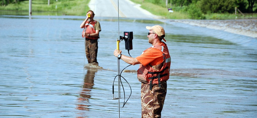 USGS personnel monitoring flood waters in Waverly, IA