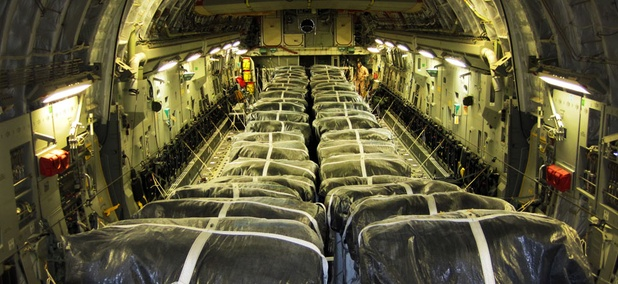 Pallets of bottled water are loaded aboard a U.S. Air Force C-17 Globemaster III aircraft in preparation for a humanitarian airdrop over Iraq Aug. 8, 2014.