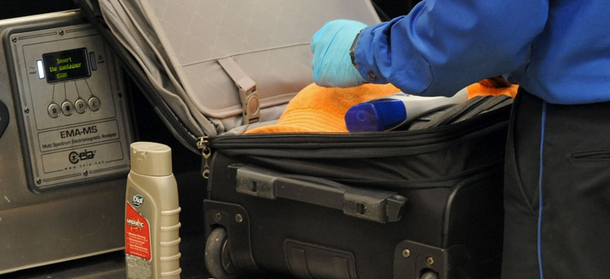A Transportation Security Administration officer discovers unallowable liquids in a passenger's carry on luggage at the security checkpoint at Hartsfield-Jackson Atlanta International Airport.