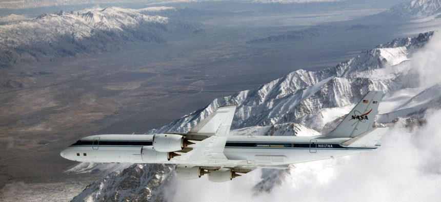 NASA's DC-8 airborne science laboratory soars over the Sierra Nevadas and the Owens Valley near Lone Pine, Calif.