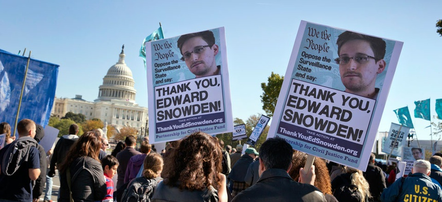 Demonstrators rally at the U.S. Capitol to protest spying on Americans by the National Security Agency.