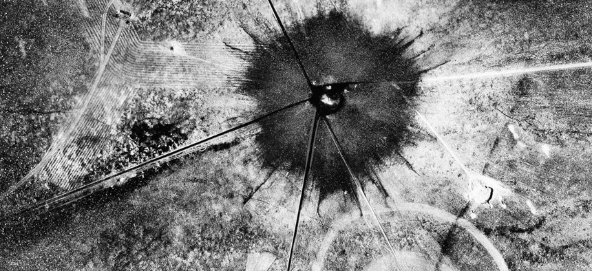 This is an aerial view of the aftermath of the first atomic explosion at Trinity Test Site, New Mexico, July 16, 1945.