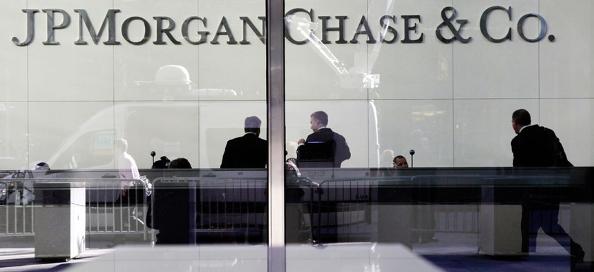 People stand in the lobby of JPMorgan's headquarters in New York.
