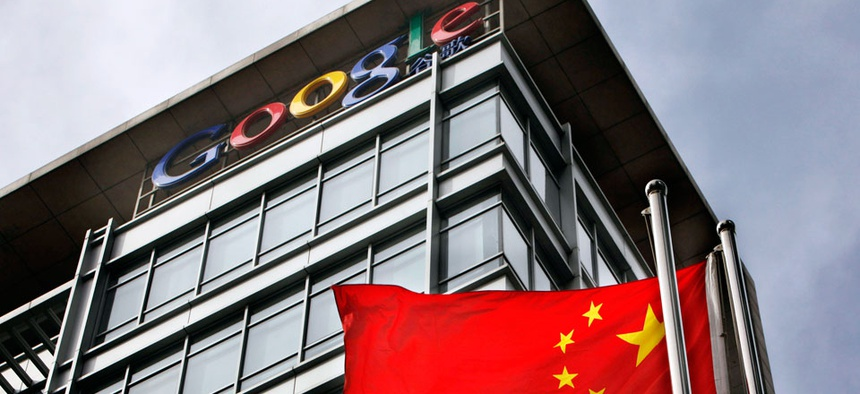 A Chinese flag flaps in the wind in front of the Google China headquarters in Beijing.