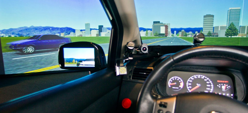 A driving telematics simulator is demonstrated at the University of Michigan Transportation Research Institute in Ann Arbor, Mich.