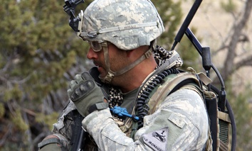A Soldier from 2nd Brigade, 1st Armored Division, uses a Joint Tactical Radio System's Handheld, Manpack and Small Form Fit.