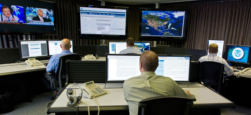 """Cyber security analysts work in the """"watch and warning center"""" during the first tour of the government's secretive cyber defense lab, in Idaho Falls, Idaho."""