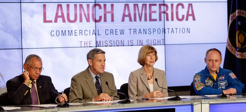 From left, NASA Administrator Charles Bolden, Kennedy Space Center Director Bob Cabana, Commercial Crew Program Manager Kathy Lueders and Astronaut Mike Fincke, announce NASA's choice of Boeing and SpaceX to ferry astronauts to the ISS.