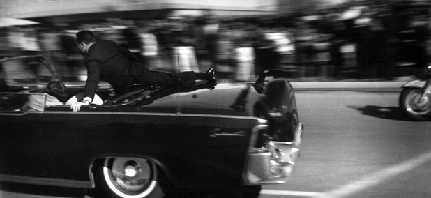 The limousine carrying mortally wounded President John F. Kennedy races toward the hospital seconds after he was shot in Dallas, on Nov. 22, 1963.