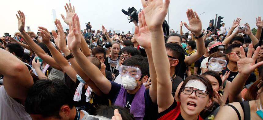 Pro-democracy student protesters confront police outside of the Chief Executive office in the government complex in Hong Kong.