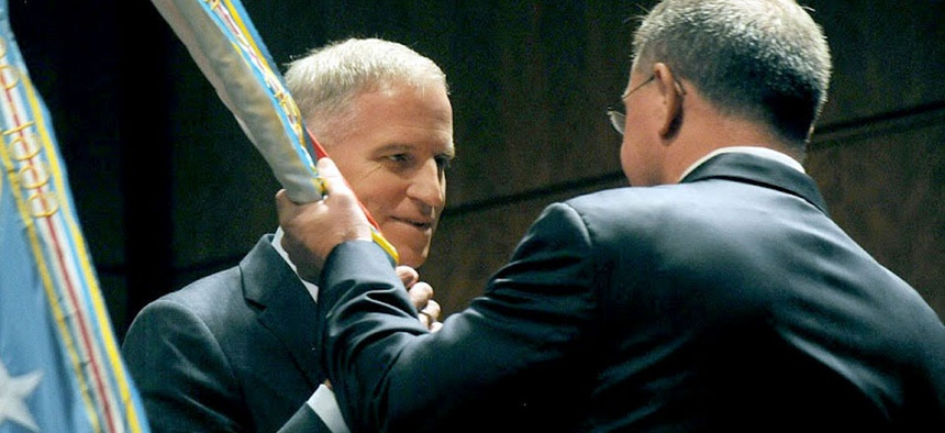 Robert Cardillo accepting the NGA colors from Undersecretary of Defense for Intelligence Michael Vickers.