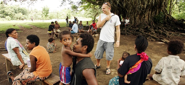 Peace Corps volunteer Joshua Fuder, center, speaks with residents of Lolovoli village on the island of Ambae, part of the Vanuatu islands chain.