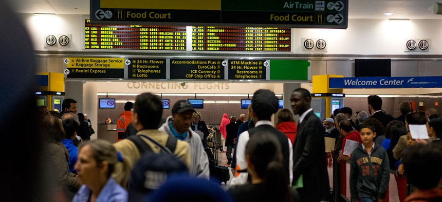 Passengers mingle in the arrivals area at John F. Kennedy International Airport in New York, Saturday, Oct. 11, 2014. Health screening procedures were put in place at the airport today to check the health of people arriving Ebola affected countries.