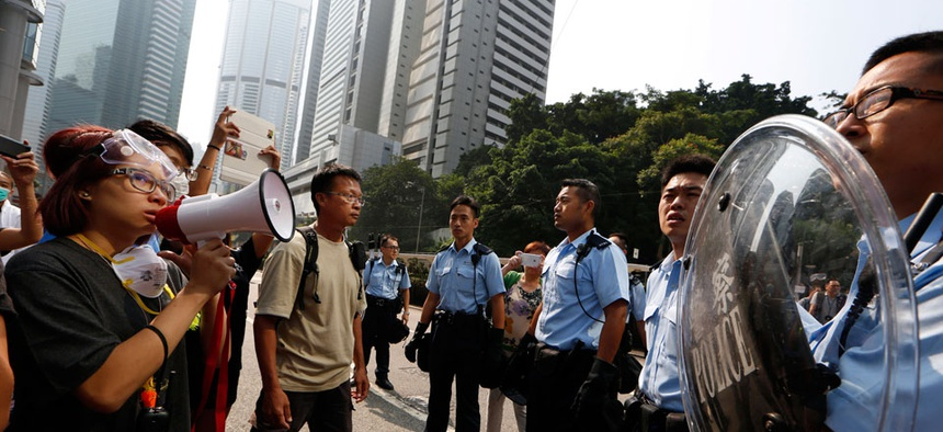 Protesters speak to the police officers in the main roads in Central district in Hong Kong Tuesday, Oct. 14, 2014.