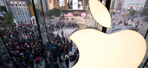 People line up to enter a newly-opened Apple Store in Wangfujing shopping district in Beijing.