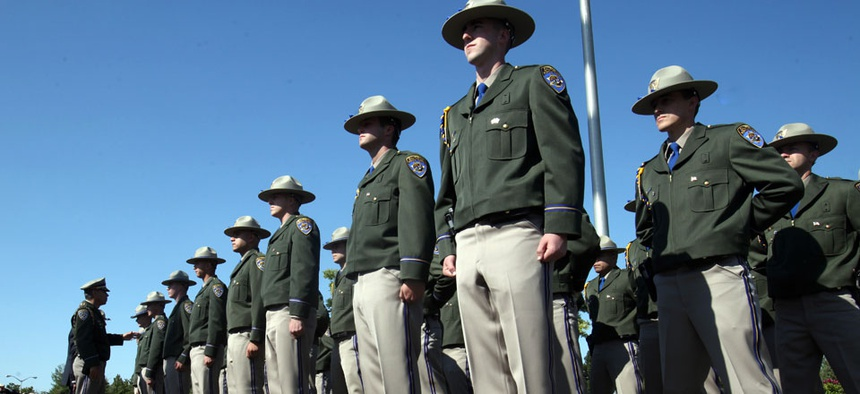 California Highway Patrol Academy cadets stand at attention during graduation ceremonies.