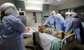 Members of the Department of Defense's Ebola Military Medical Support Team go through special training at San Antonio Military Medical Center.