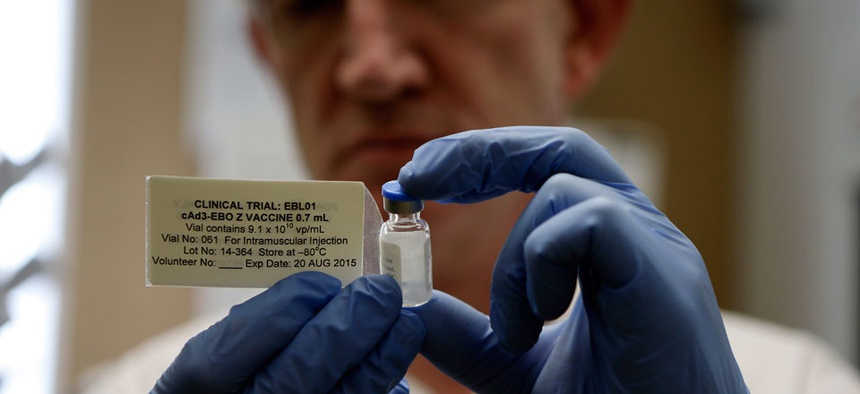 Professor Adrian Hill, Director leader of the trials for the experimental Ebola vaccine holds a vial of the vaccine in Oxford, England Wednesday Sept. 17, 2014.