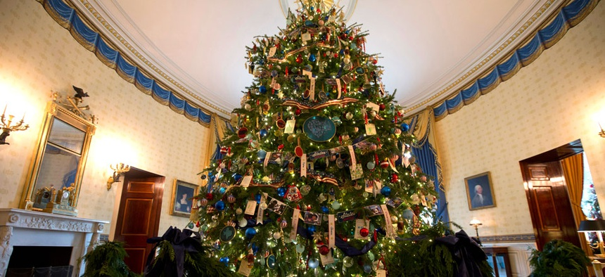 The White House Christmas tree is seen in the Blue Room of the White House in Washington, on Wednesday, Dec. 4, 2013.