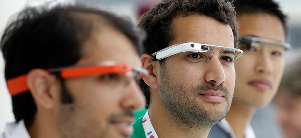 Google Glass team members wear Google Glasses at a booth at Google I/O 2013 in San Francisco.