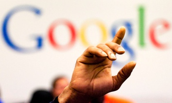 a man raises his hand during a meeting at Google offices, Oct. 17, 2012.