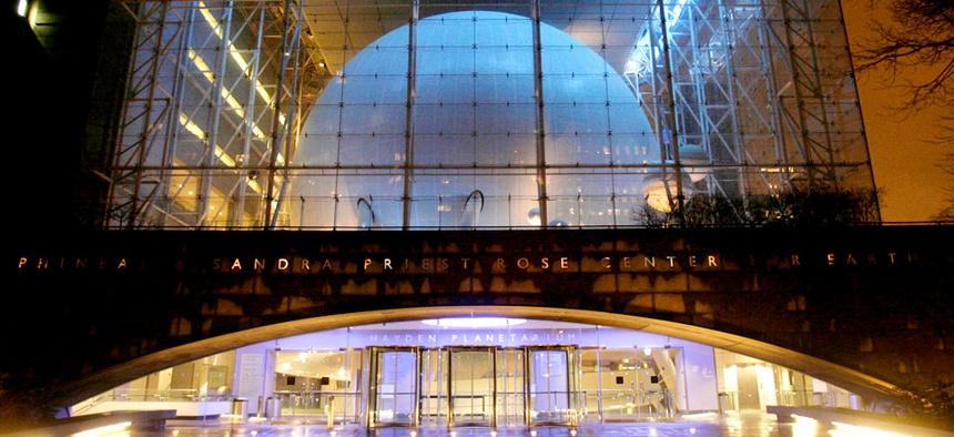 The Hayden Planetarium is seen at night in New York.