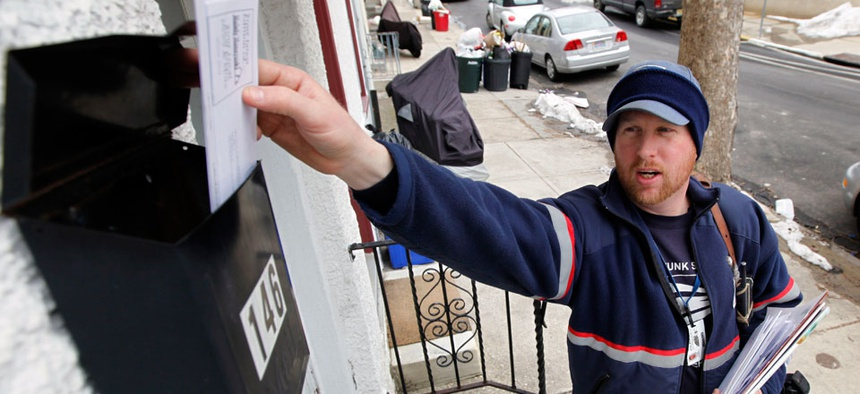 Letter carrier Kevin Pownall delivers mail in Philadelphia.