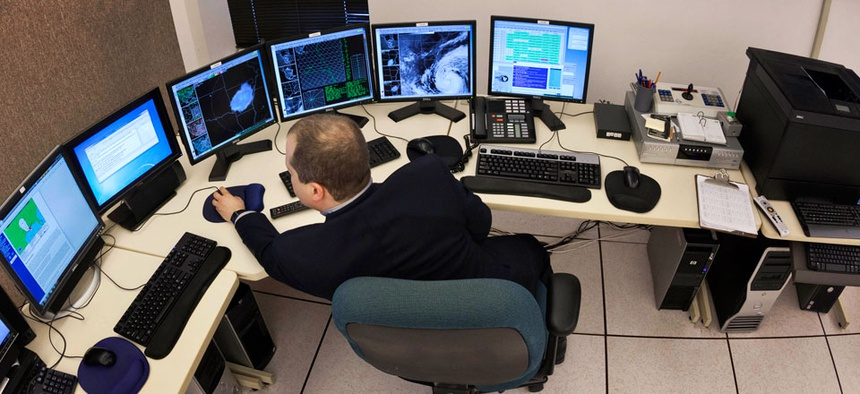 Science and operations officer Christopher Buonanno monitors data on Hurricane Isaac at the National Weather Service Warning and Forecast Office in North Little Rock, Ark.